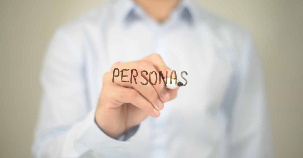 """Person writing """"personas"""" on glass"""