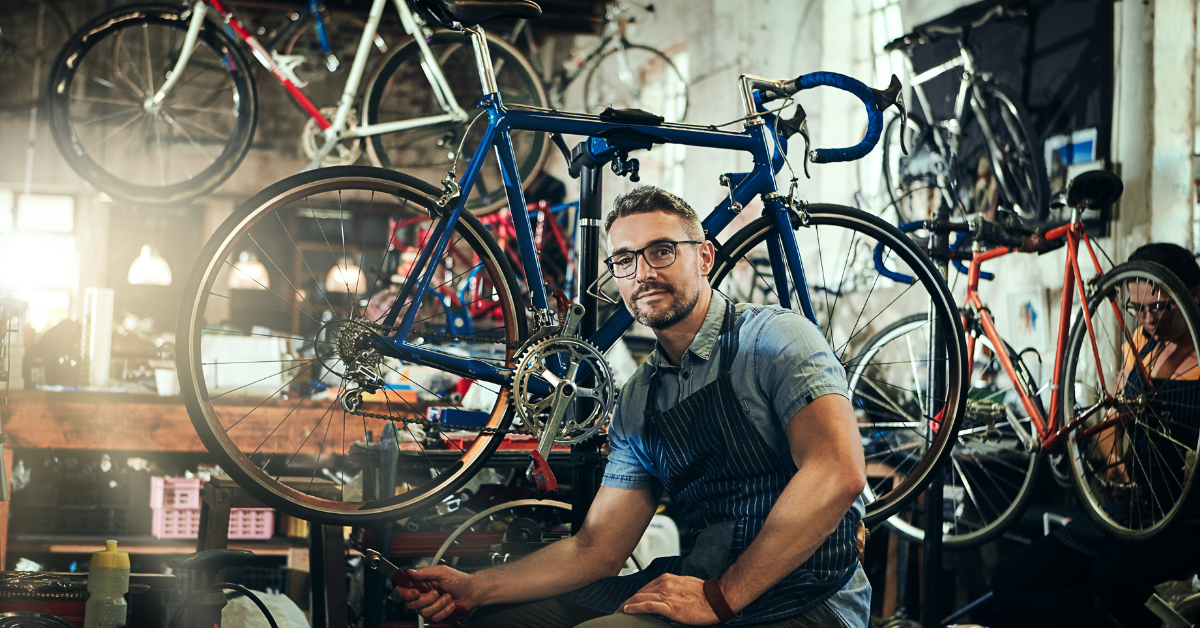 Male in front of bikes in a workshop